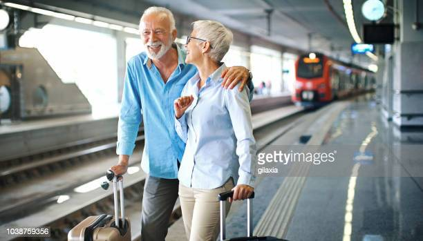 waiting for a train. - passenger train stock pictures, royalty-free photos & images