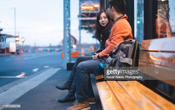 waiting for bus at bus stop. - nazar abbas photography stock pictures, royalty-free photos & images