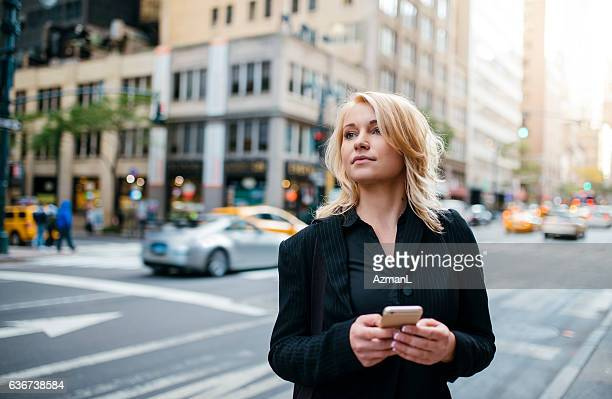 Waiting for taxi and texting