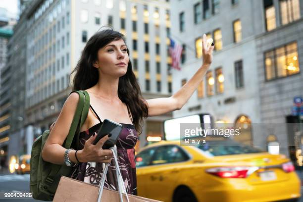 waiting for taxi - fifth avenue stock pictures, royalty-free photos & images