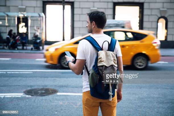 waiting for taxi - yellow taxi stock pictures, royalty-free photos & images