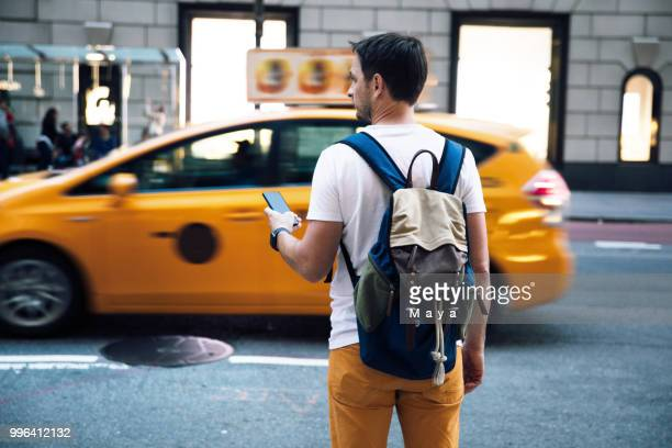 waiting for taxi - lyft stock photos and pictures