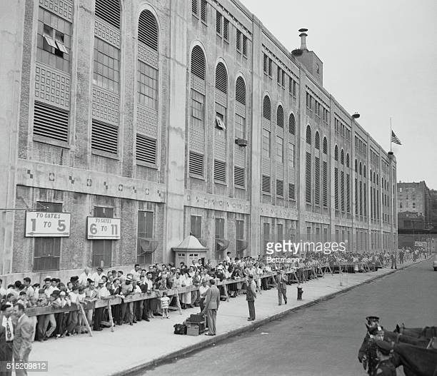 Waiting for the Babe to come homeCrowds line the sidewalk around Yankee Stadium August 17th awaiting the arrival of the coffin bearing Babe Ruth The...