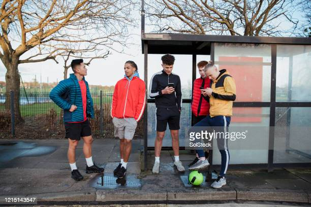 waiting for the bus - football stock pictures, royalty-free photos & images