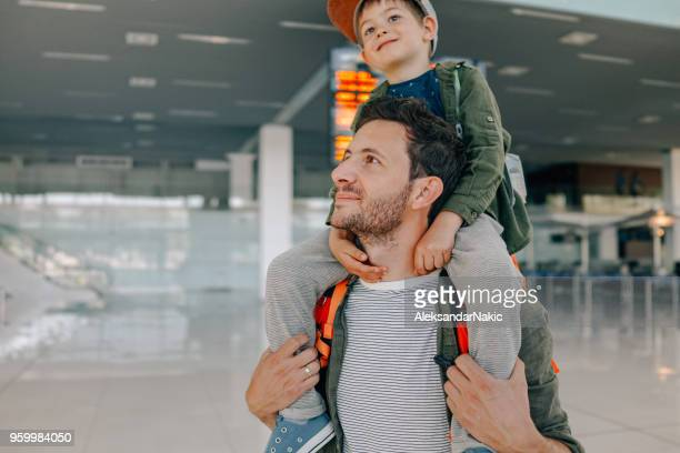 waiting for the flight - carrying a person on shoulders stock photos and pictures
