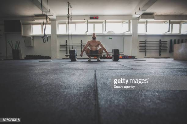 waiting for the right moment - snatch weightlifting stock photos and pictures