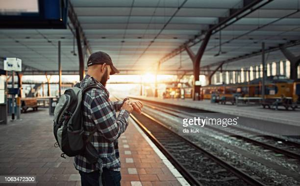 waiting for the train at railway station - station stock pictures, royalty-free photos & images