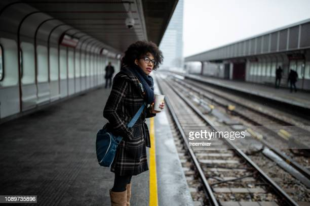 waiting for the train - waiting stock pictures, royalty-free photos & images
