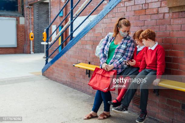 waiting for the train - education stock pictures, royalty-free photos & images