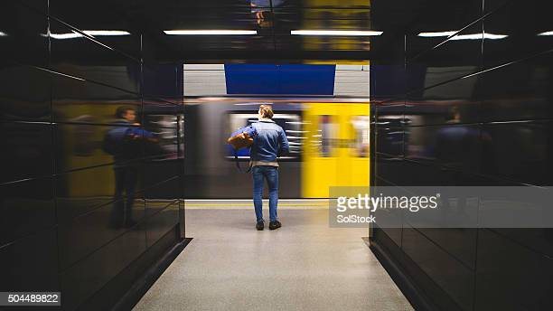 waiting for the train - subway platform stock pictures, royalty-free photos & images