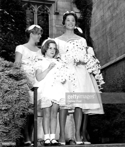 Waiting for their cue to enter the chapel are two of the bridesmaids Miss Edith Fenton of Wilmington, Del., Mrs. John Brooks Jr. Of Denver and the...