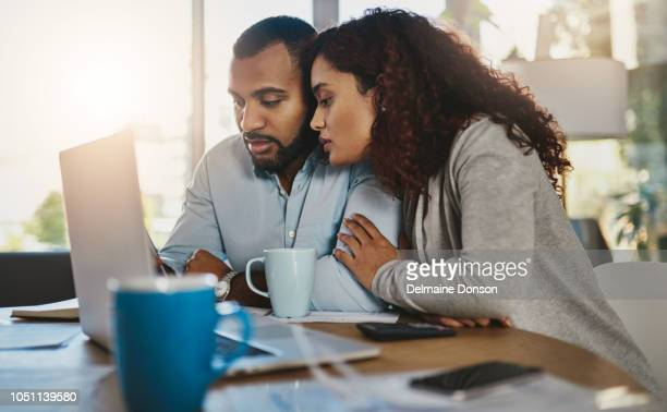 waiting for their payment notification to come through - life insurance stock pictures, royalty-free photos & images