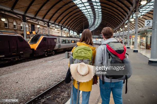 waiting for train - railway station stock pictures, royalty-free photos & images