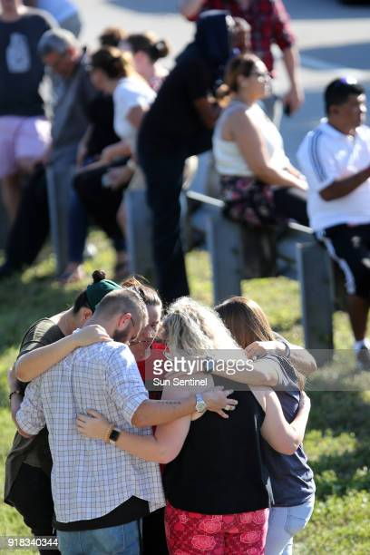 Waiting for word from students at Coral Springs Drive and the Sawgrass Expressway just south of the campus of Stoneman Douglas High School in...