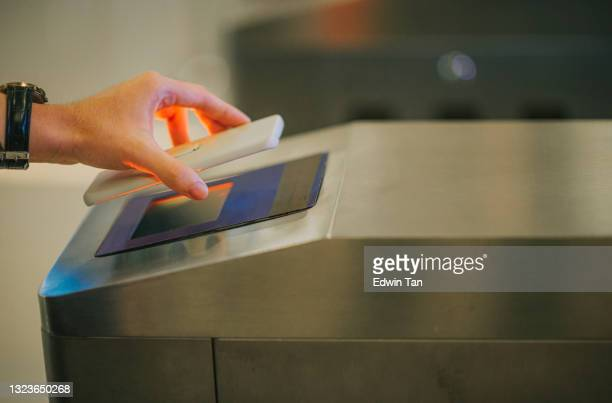 waiting in line e-ticketing asian chinese man hand using smart phone mobile app barcode scanning at movie theater entrance - sport venue stock pictures, royalty-free photos & images