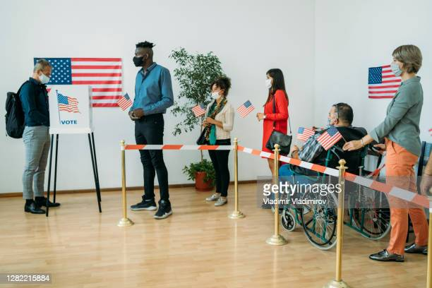 waiting in line for voting - presidential candidate stock pictures, royalty-free photos & images