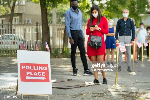 waiting in line on election day - polling station stock pictures, royalty-free photos & images