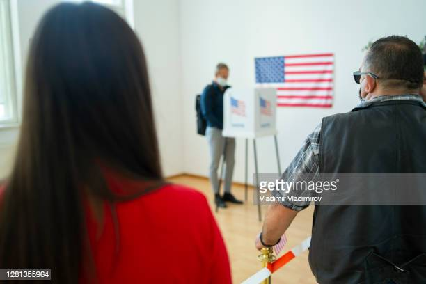 waiting in line on election day - presidential candidate stock pictures, royalty-free photos & images