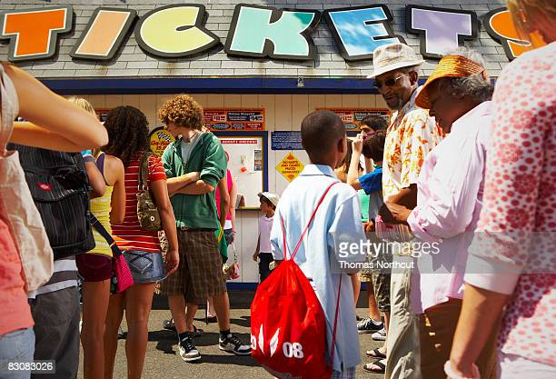 waiting in ticket line at amusement park