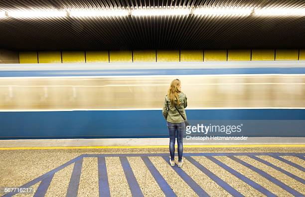 waiting on her train - subway platform stock pictures, royalty-free photos & images