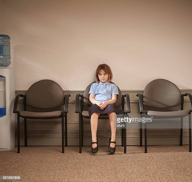 waiting outside the head's office