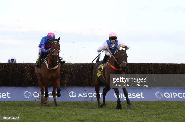 Waiting Patiently and Brian Hughes lead Cue Card and Paddy Brennan away from the last fence before going on to win The Betfair Ascot Steeple Chase...