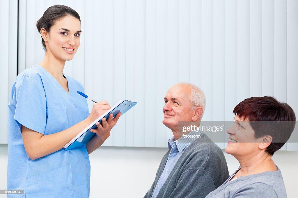 Waiting room - Nurse filling form : Stock Photo