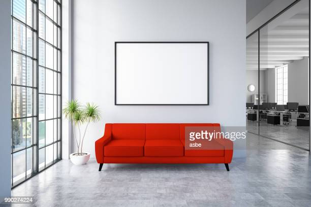 waiting room with empty frame and red sofa - hotel lobby stock pictures, royalty-free photos & images