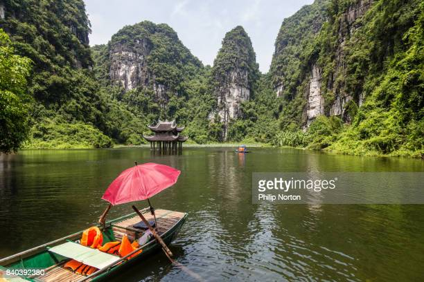 Waiting sampan on the waterway near Trang An