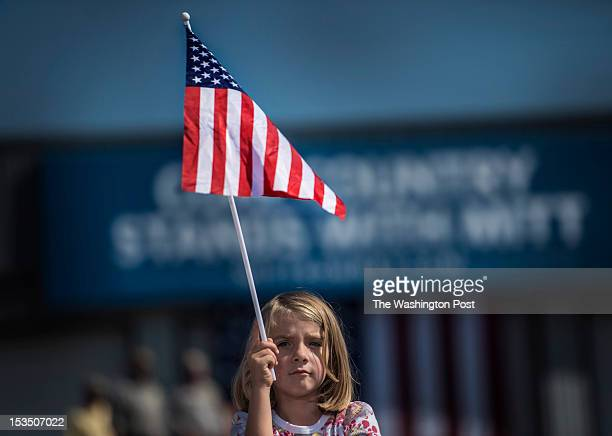 A waiting supporter's daughter waits for Republican nominee for President Governor Mitt Romney at a rally in south western Virginia in Abingdon...