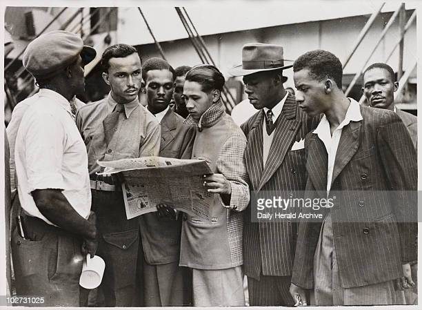 Waiting to disembark from the 'Empire Windrush' 21 June 1948 A photograph of passengers reading a newspaper whilst waiting to disembark from the...
