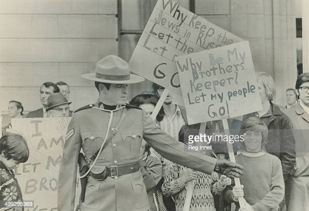 Waiting to protest outside the staid Rideau Club in Ottawa where visiting Premier Alexei Kosygin today entertained Prime Minister Pierre Trudeau and...