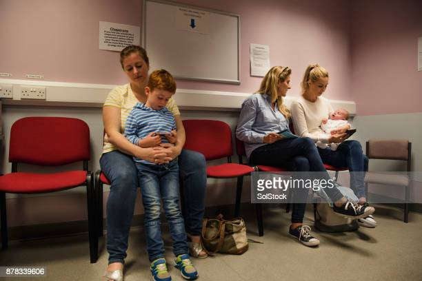 waiting to see the doctor - doctor's surgery stock pictures, royalty-free photos & images