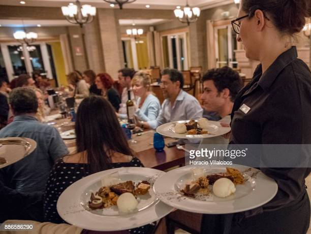 Waitress Ana Ferreira serves dessert during dinner in Dolce CampoReal Lisboa Hotel for participants of Gastronomic FAM Tour on November 26 2017 in...