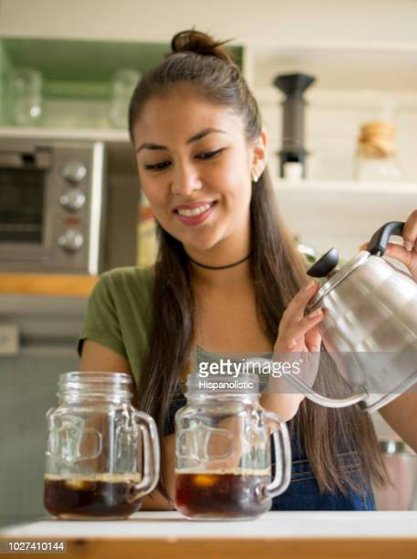 Waitress at a bakery serving iced coffee