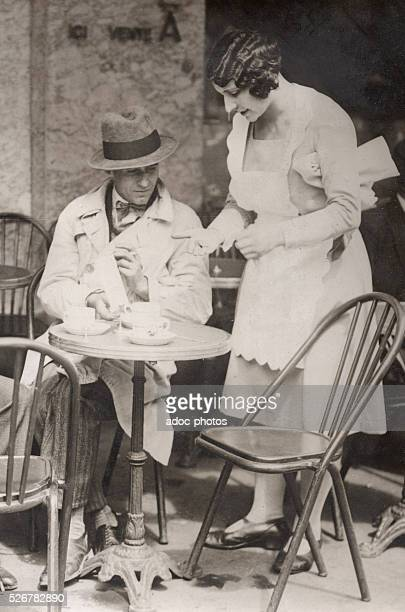 A waitress at a cafe terrace in Paris In August 1930