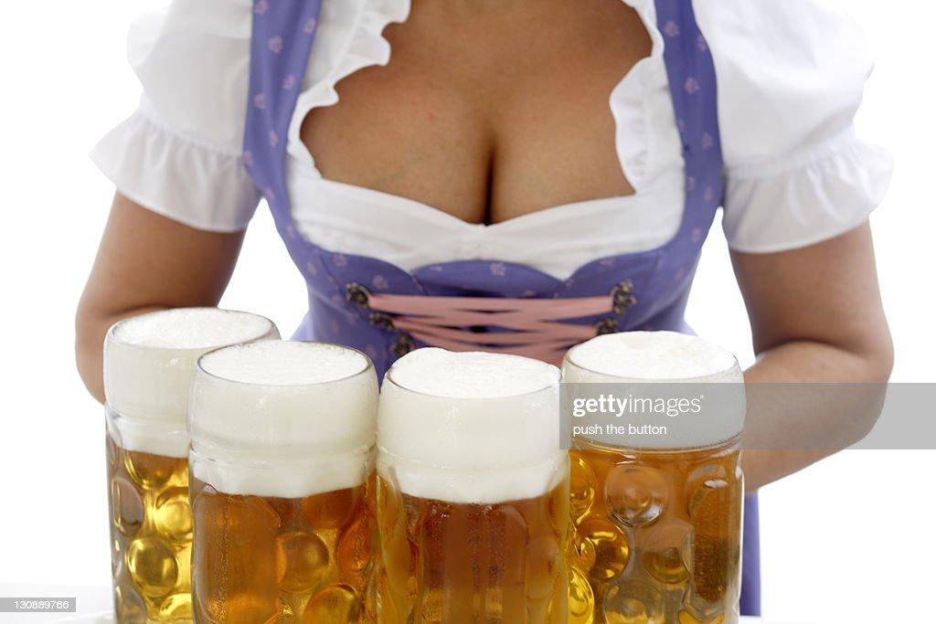Waitress at beerfestival, closeup : Stock Photo