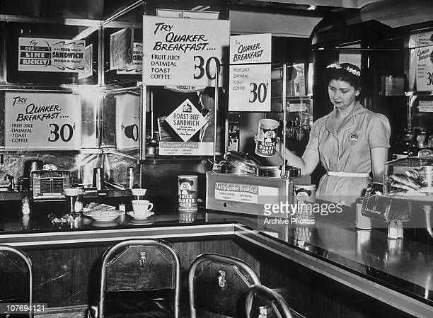 Waitress behind the counter of a diner specializing in Quaker oatmeal dishes, USA, circa 1935.