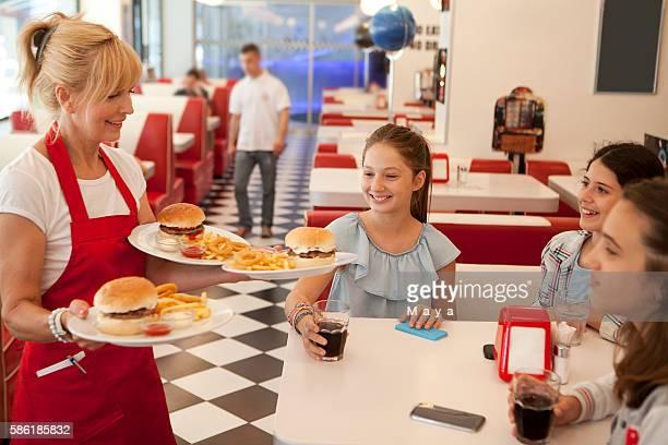 Waitress bringing meal