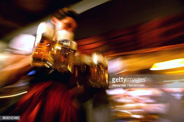 A waitress brings glasses of beer to the heads of the six Munich breweries as well as the owners of the Oktoberfest tents for the annual beer tasting...