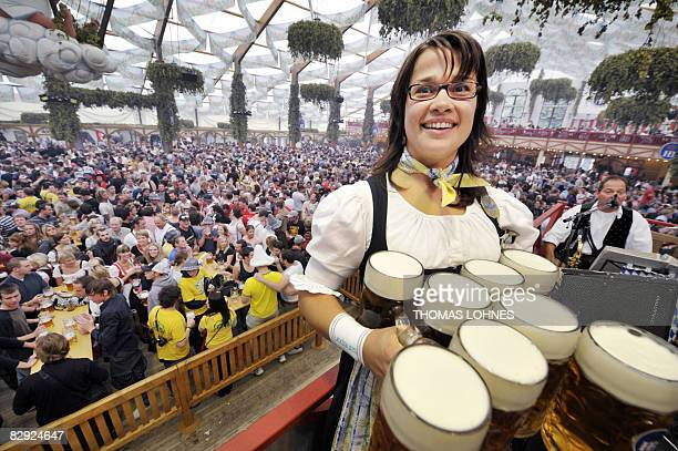 A waitress carries beers after the opening of the Oktoberfest beer festival on September 20 2008 at the 'Theresienwiese' in Munich southern Germany...