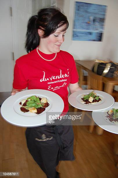 DESHAYES A waitress carries plates of whale meat in a restaurant in Svolvaer on August 20 2008 In the Lofoten archipelago the centre of the whaling...
