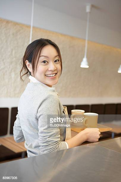 Waitress carrying a tray