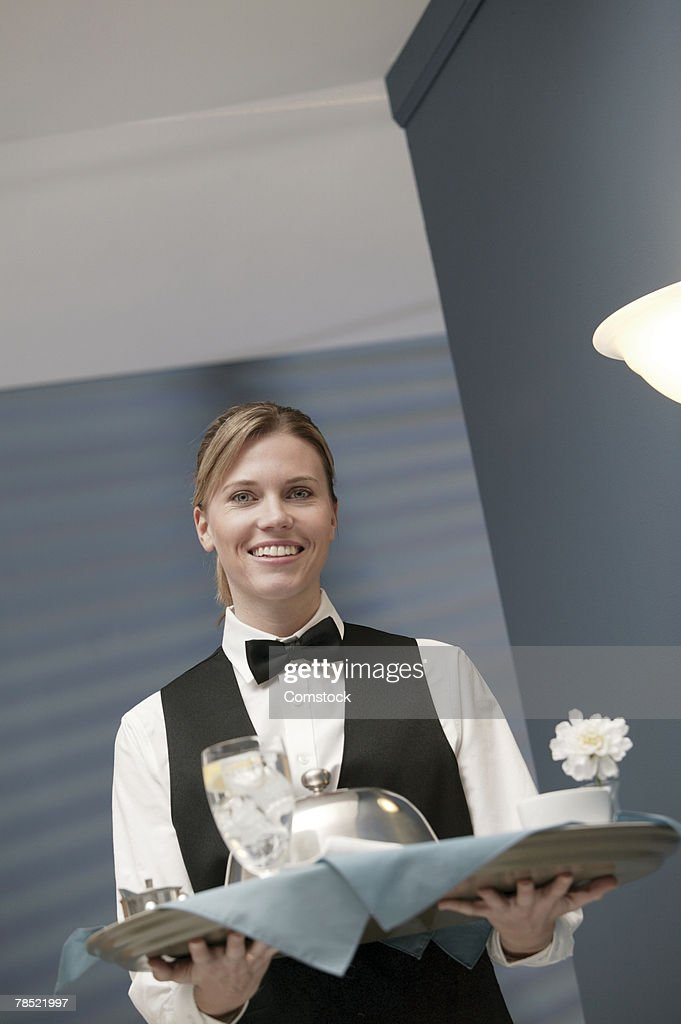 Waitress carrying food tray : Stock Photo