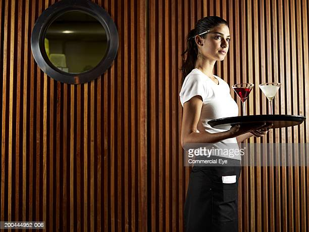 Waitress carrying tray with drinks