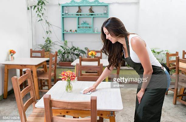 Waitress cleaning tables at a restaurant