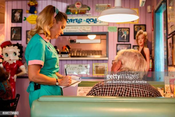 Waitress delivers breakfast at Peggy Sue's Americana Route 66 inspired diner in Yermo California about eight miles outside of Barstow