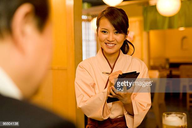 A Waitress Getting Orders
