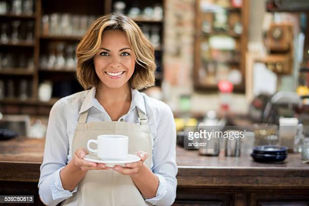 Waitress holding a cup of coffee