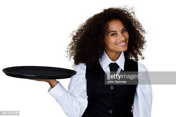 waitress holding a serving tray - serving tray stock pictures, royalty-free photos & images